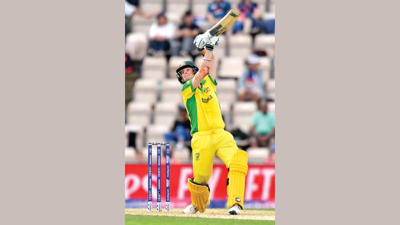 Australia's Steve Smith hits a six during their 2019 Cricket World Cup warm up match against England at the Rose Bowl in Southampton, southern England yesterday (Photo by Glyn KIRK / AFP)