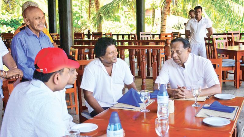 Minister Amaratunga with officials at Bentota.
