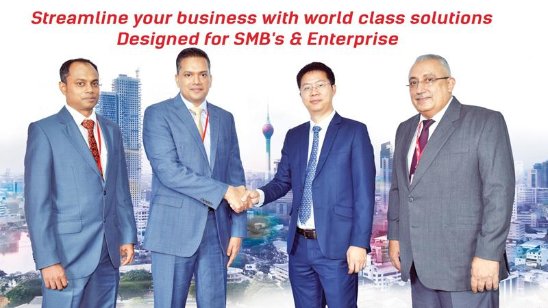 After the signing of the agreement. From left: Chief Technical Officer, Bartleet IT, Dhanushka Arachchige, Managing Director of the Bartleet Group, Eshanth Wijesinghe, Regional Director, International Business Division, Ruijie Networks Co. Ltd., Lim Shi and Director/CEO - Bartleet IT, Omar Lebbé.
