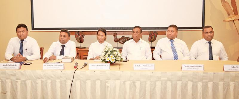 The head table. From left: General Manager Kapila Rajapakshe, General Manager Dr. Mangala Amarasinghe, Directress Punya Nanayakkara, Chairman W. G. Eddie Gunapala Nanayakkara, General Manager Parakrama Girihagama, Chief Finance Officer Nalin Silva.