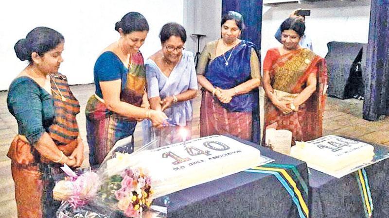 Principal, Girls' High School, Kandy, Malkanthi Abeygunasekera along with the Secretary of the OGA Kamini Kodituwakku cutting the cake while the senior teachers and members of the OGA look on.