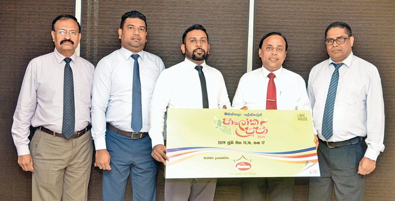 Ceylon Biscuits Limited, a co-sponsor for the 57th Mihintala Lake House Aloka Pooja organised by the Associated Newspapers of Ceylon Limited (ANCL), presented the sponsorship cheque to ANCL Deputy General Manager (Advertising) Waruna Mallawaarachchi at the CBL premises. Here, Mallawaarachchi receives the cheque from CBL General Manager (Marketing) Janmesh Paul Anthony. CBL Public Relations Manager Janaka Botheju, Assistant Marketing Manager Romesh Jayathilake and ANCL Deputy General Manager (Finance) Viraj