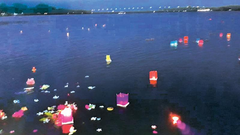 Candles and flowers picked from the gardens of the little ones of BEYS float at the Batticaloa lagoon