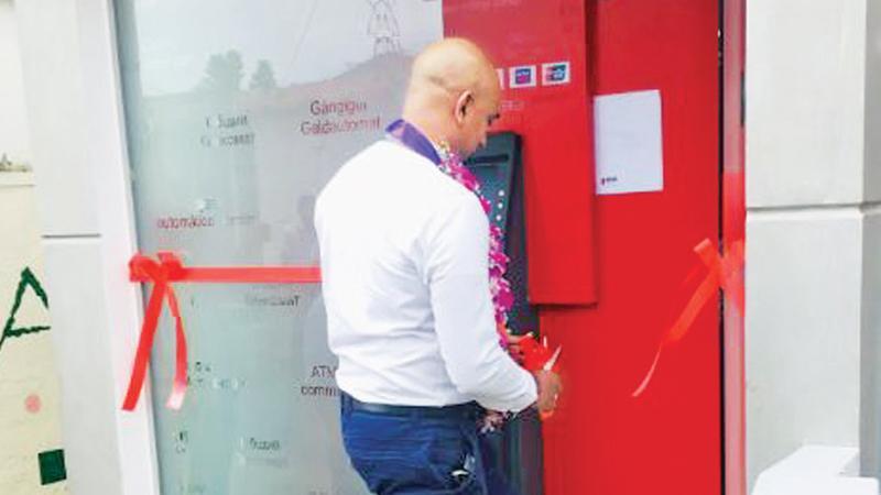 Head of Digital Banking Channels at Seylan Bank, Chami Senewiratne opens the ATM unit.