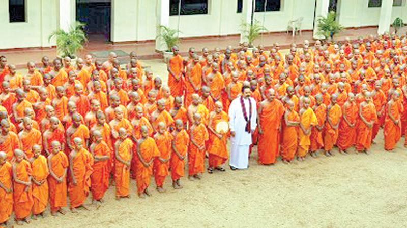 President Mahinda Rajapaksa at the Asgiriya Chapter temple in Kandy, to open a new Pirivena building on the premises in 2009 (File photo)