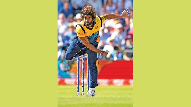 Lasith Malinga bowls during his four wicket haul (AFP)