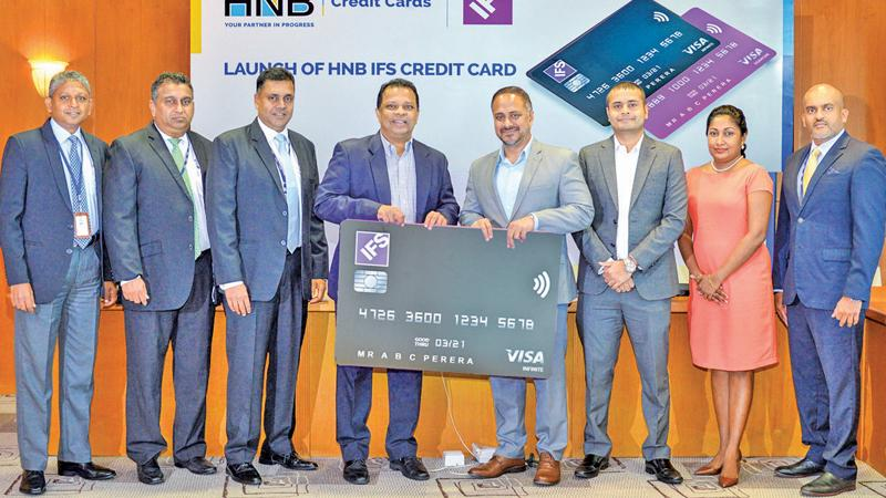 After the signing of the agreement. From left:  Head of Business Development, HNB, Supun Dias, Chief  Information Officer, HNB, Ruwan Bakmedeniya, Deputy General Manager, Retail Banking, HNB, Sanjay Wijemanne, Managing Director/CEO, HNB . Jonathan Alles, Managing Director/Vice President Sales, South East Asia, IFS, Shiraz Lye,  Head of Key Accounts - Sri Lanka, IFS, Shanaz Sheriff, Head of Marketing, Middle East and South Asia, IFS, Dilini Ratnayake and Head of Cards, HNB,   Roshantha Jayatunge.