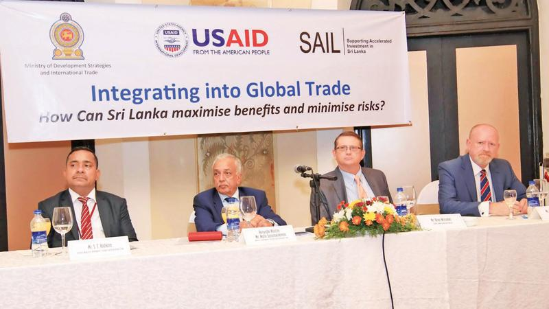 The head table: From left - Secretary, MODSIT, Sisira Kodikara, Minister  Samarawickrema, Guest of Honour, USAID Director, Brian Wittnebel and Chief of Party USAID-SAIL Project, Glenn Mackenzie-Frazer.