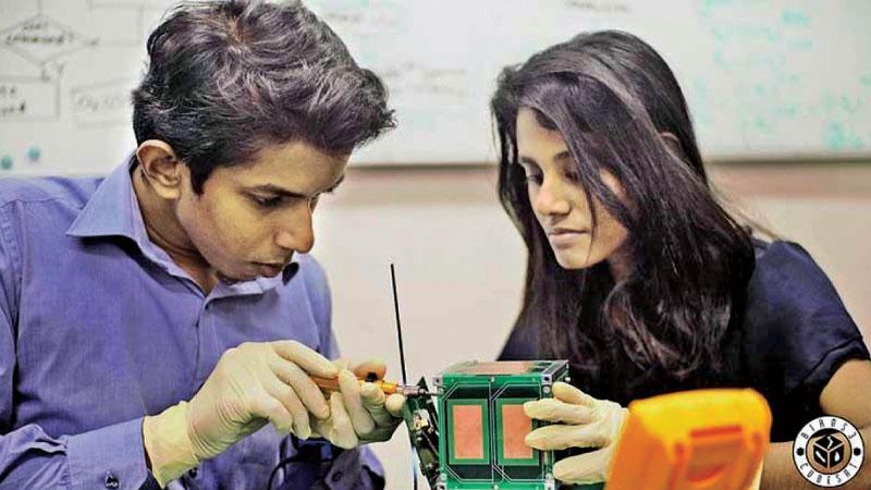 Tharindu Dayarathna and Dulani Chamika adding the final touches