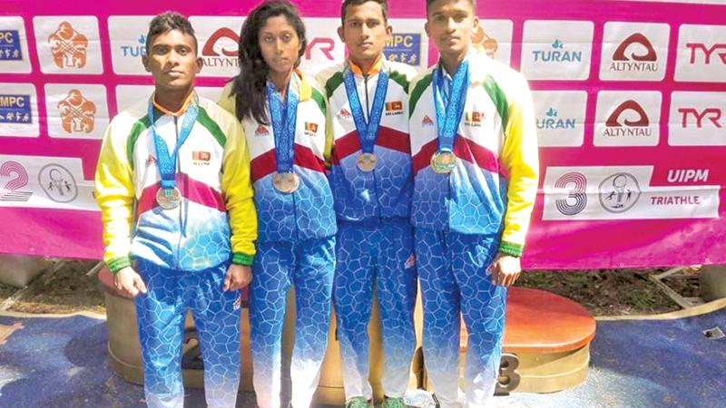 The medal-winning Sri Lankan foursome of Asanka Nilaweera, Sajeewa Udayanga, Dilanka Rajapakse and Gayani Dasanayake who were coached by Subasiri Perera