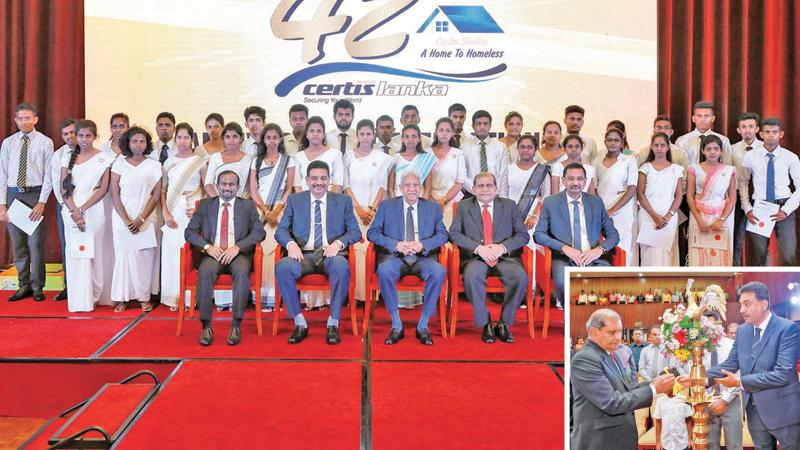 The award winners at the 42nd anniversary celebrations of Certis Lanka  Group. (On right): The lighting of the lamp by top officials to begin proceedings.