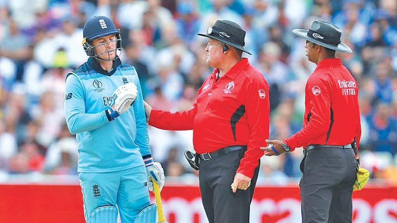Umpires Kumara Dharmasena (right) and Marias Erasmus talk to Roy