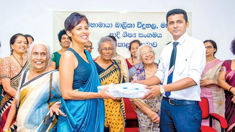 Dr. Sreemali Herath, President PPA Mahamaya Girls' College, Kandy (Colombo Branch) handing over the medical equipment to Prof Rohan Siriwardana