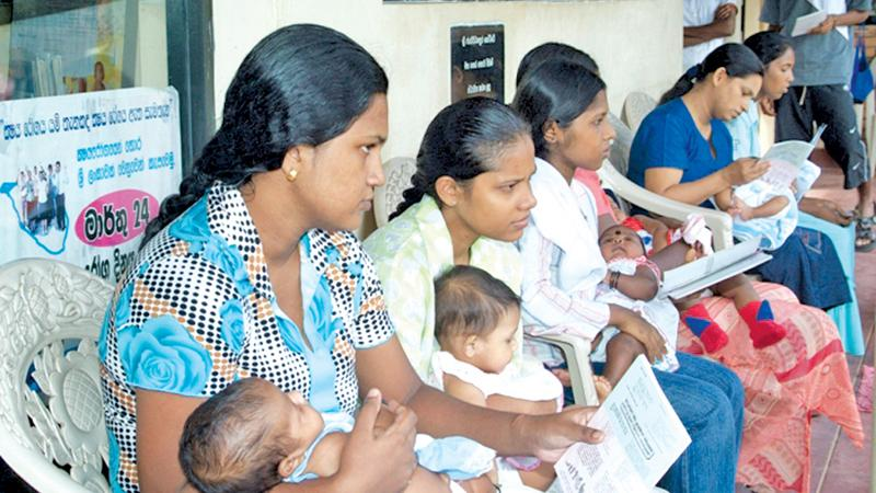 Mothers waiting at a primary medical care facility to vaccinate children