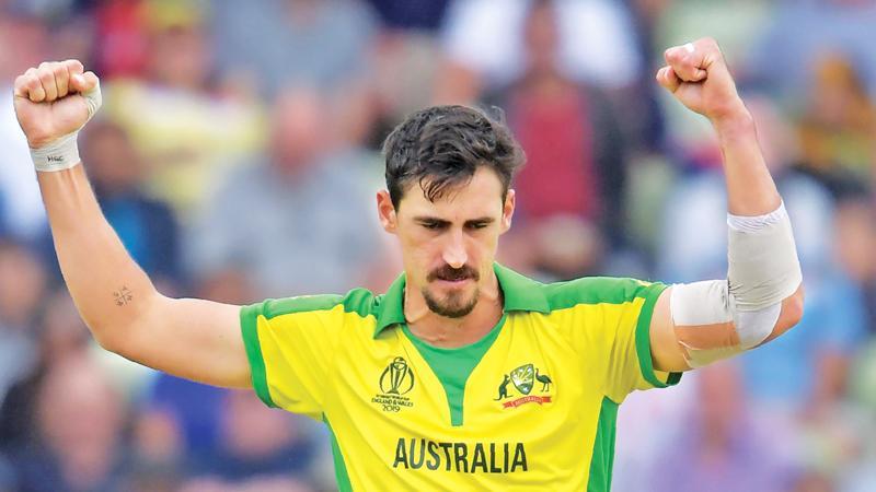 Australia's Mitchell Starc celebrates (AFP)
