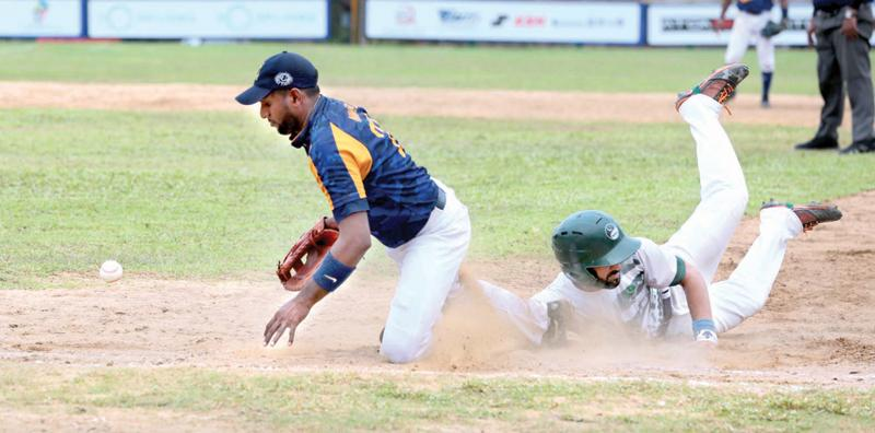 A Pakistan batter makes his ground just in time in the final against Sri Lanka (Pix: Shan Rambukwella)