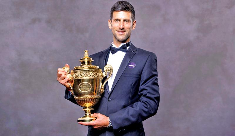 2019 Wimbledon Men's singles champion Serbia's Novak Djokovic posing for a photograph with his trophy (AFP)