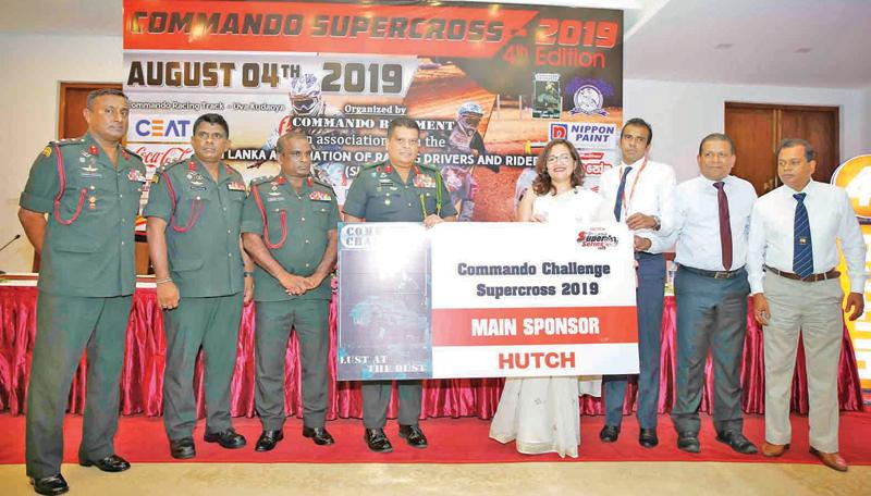 Chief of Staff and Center Commandant Commando Regiment Shavendra Silva accepting the main sponsorship for the Commando Challenge Super Cross from Ramzeena, Lye head of Sales and Marketing Hutchison Telecommunication Lanka. Also in the picture is Commandant Commando Base Ganemulla Brigadier Shamal Silva.  Picture by Rukmal Gamage
