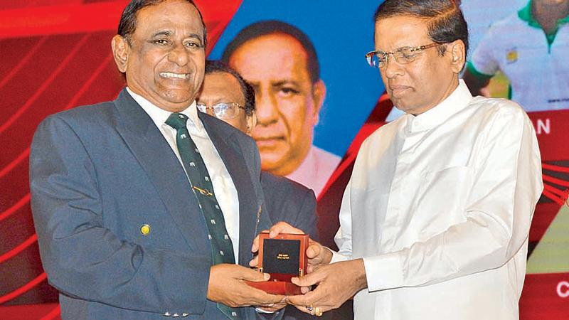 Nimal Lewke receiving the Kreeda Bhushana award from President Maithripala Sirisena for his yeomen services to rugby. Lewke was also a front-line boxer during his heydays besides being a crack commando who served as Deputy Inspector General in the Special Task Force (STF)