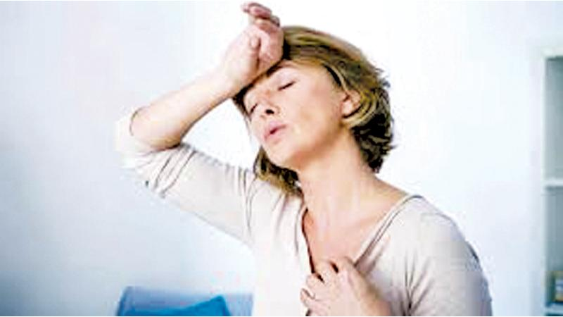 The first sign is hot flushes and excessive sweating with irregular periods