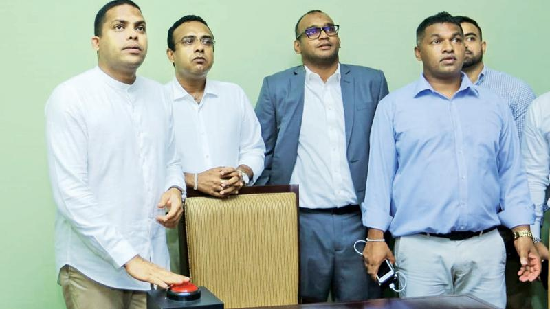 Sports Minister Harin Fernando launching the Sugathadasa Stadium Complex web site at a ceremony held on Friday in the presence of Manusha Nanayakkara MP and manager of the Sugathadasa Stadium Complex Sampath Perera