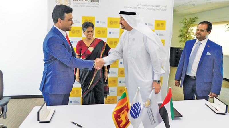 Deputy Minister of Development Strategies and International Trade, Nalin Bandara greets a Dubai Expo official at the contract signing ceremony.