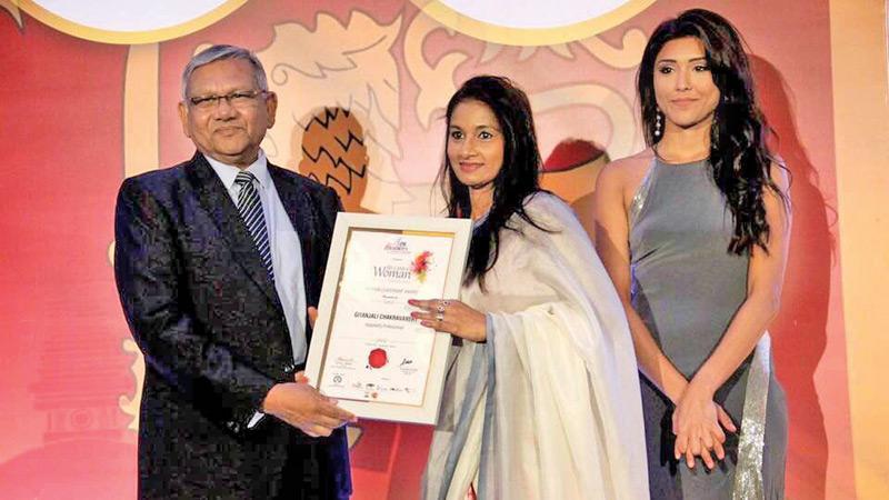Gitanjali Chakravarthy Haaland receiving the Woman Leadership Award