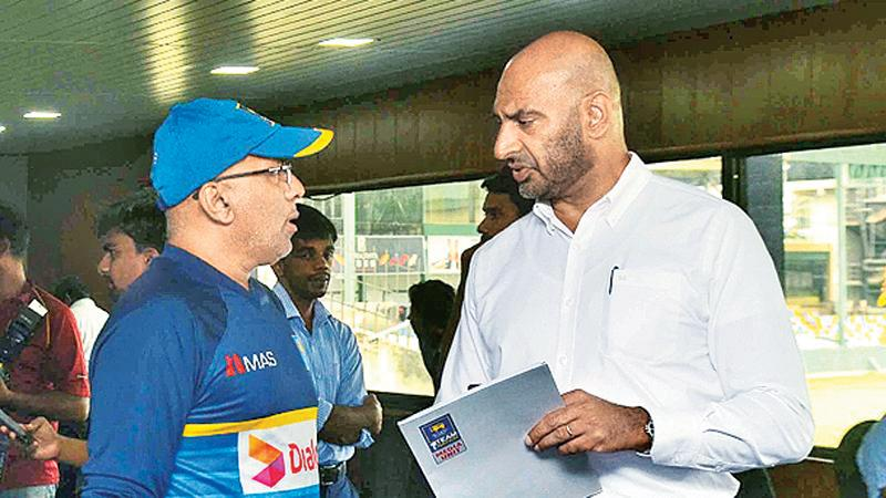 Chandika Hathurusinha (left) with former head Selector Graeme Labrooy when things were not as bad as it is today