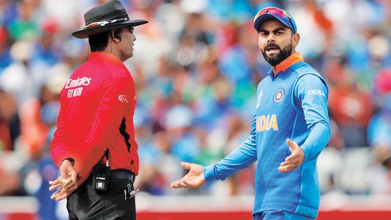 Virat Kohli (right) wins accolades