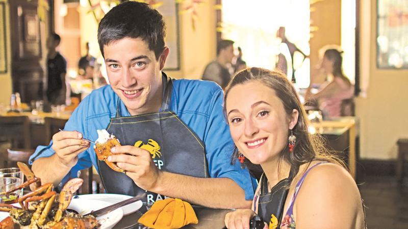 Sabrina and Luke enjoy a crab dish in Colombo