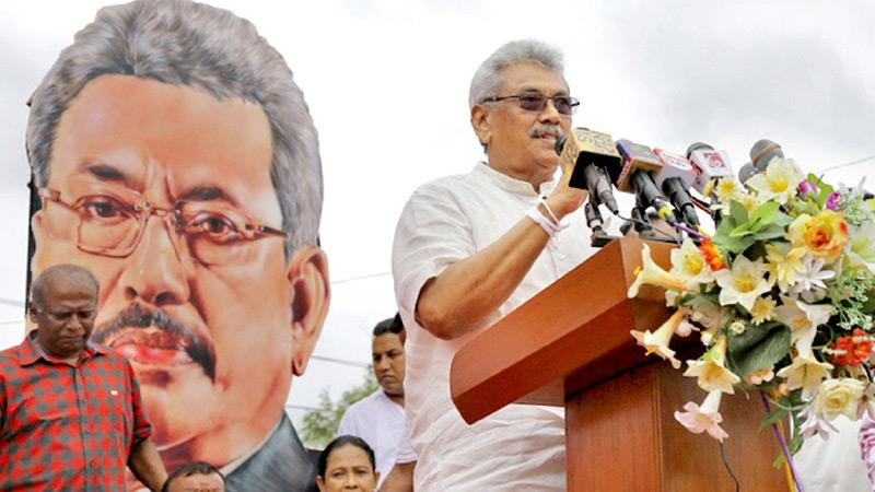 SLPP Presidential candidate Gotabaya Rajapaksa with a menacing cut-out looming behind