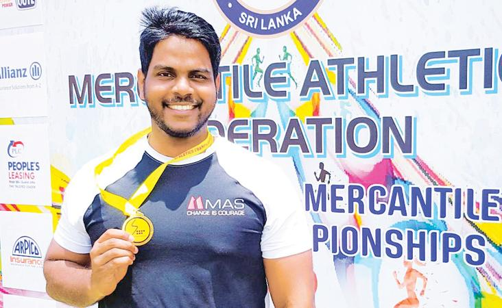 Lakshan Fernando with  the gold medal