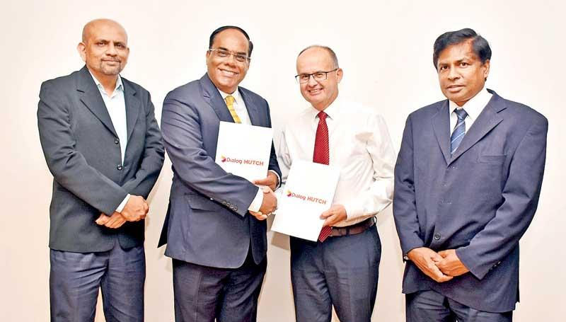 At the launch. From left -  Group Chief Corporate Officer, Dialog Axiata, Shayam Majeed, CEO, Hutch, Thirukumar Nadarasa, Group Chief Officer, Dialog Enterprise, Dialog Axiata, Jeremy E. Huxtable,  and Director-General, Department of Agriculture,   Dr. W. M. W. Weerakoon.