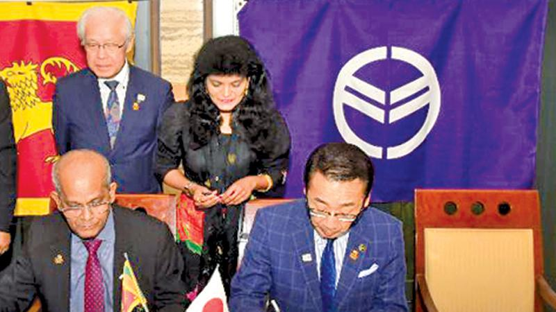 NOC General Secretary Maxwell de Silva (left) signing the MoU with Mayor of Hashima City