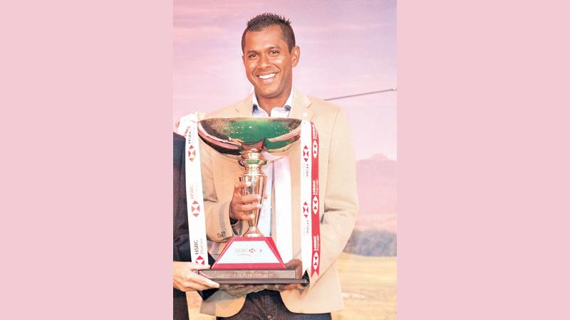 Rajeev Rajapakse with the HSBC Premier Challenge Trophy