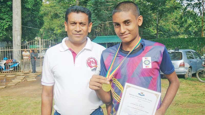 Kavindu Rashmika with his coach  Lalith Ratnayake