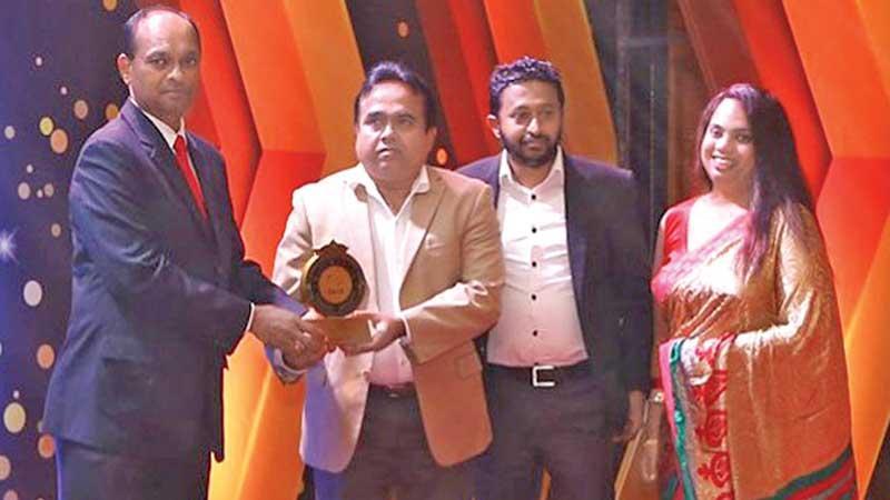 General Manager, SLT, Rohana Ellawala receives the award from Director, IT, Parliament of Sri Lanka, Mahesh Perer (on left).  SLT website Coordinator, Harshana Henarath and Manager, SLT, Umesha Sandarenu look on.