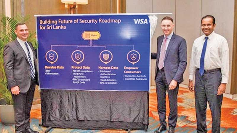 Visa Asia Pacific Head of Risk, Joe Cunningham unveils the Building Future of Security Roadmap for Sri Lanka at the Shangri-La Hotel, Colombo. PCIASL Chairman Thusitha Suraweera and Visa Country Manager Sri Lanka and the Maldives Anthony Watson look on.