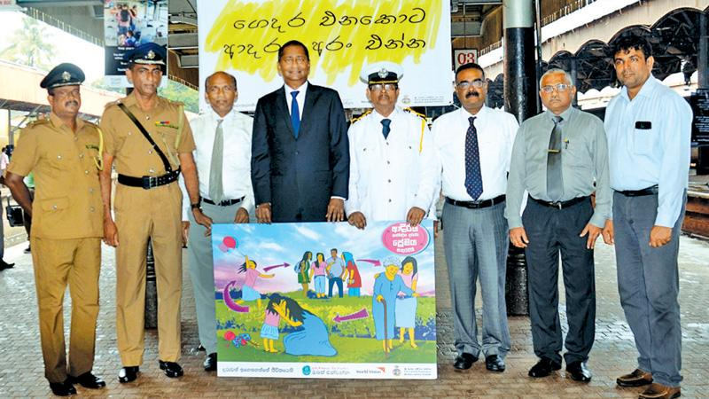 World Vision Sri Lanka and SL Railways officials with poster