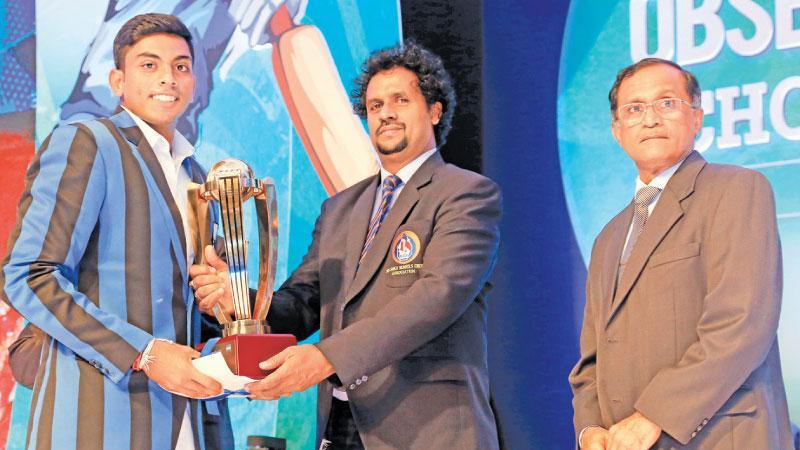 S. Thomas Collage,  Kalana Perera, receiving the Best Bowler award for Division - 1