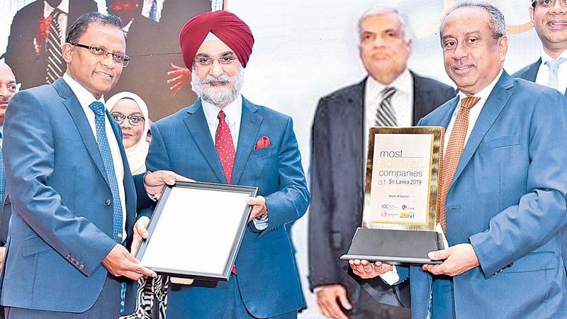 BOC Chairman Ronald  C. Perera and CEO/General Manager Senarath  Bandara with the awards.