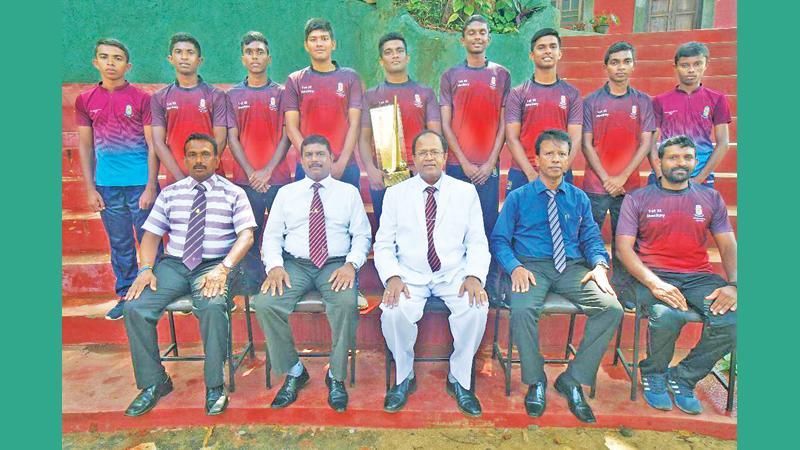 The victorious Dharmaraja College team: Standing from left: C. Silva, T. Herath, S. Attanayake, U.Gimhana, C. Abeyratne (Capt) D. Samarasinghe, S.Weerasinghe, H. Bandara and T.Pallewatte Seated from left: Indrawansa Herath (coach) Saliya Samarawickrema (POG), Dampiya Wanasinghe (principal) Jagath Dharmasiri (MIC) and AB Godigamuwa (assistant coach)