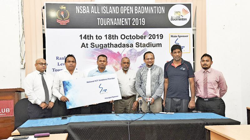 Sri Lanka Telecom Corporate Relations General Manager Rohan Ellawala (left) presenting the sponsorship cheque to Nationalised Services Badminton Association Secretary Upul Gamlath in the presence of Sri Lanka Badminton (SLB) President Rohan de Silva