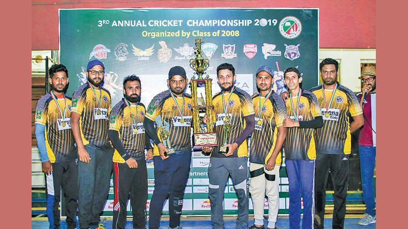 Captain of the champion Strange Giants team SM Usman and members of the side Naleer Lee, M. Nuhaz, Faizan Naseer, M. Muiz, M. Farhan, Sharfan Ameer and M. Mafaza with the champion award