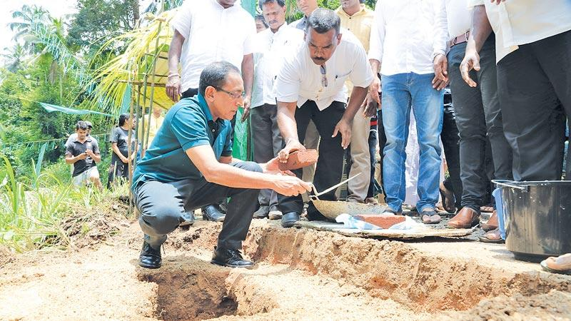 Minister Kabir Hassim lays the foundation stone for one of the projects.