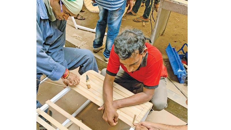 Local artisans in a hands-on training session in UNIDO's bamboo workshop.
