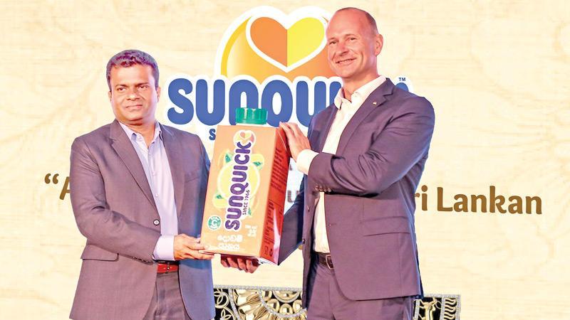 President, CO-RO A/S Denmark, Soren Holm Jensen presents the Sunquick RTD dummy pack to Director, Sunquick Lanka, Mangala Perera.
