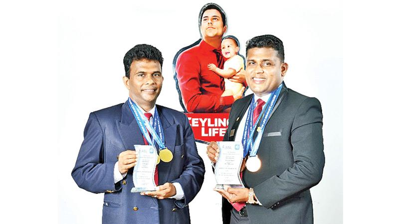 Ceylinco Life's award winners G. G. Botheju (left) and A. I. P. Manjula.