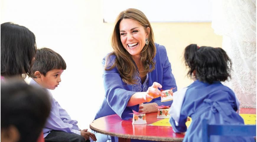 Kate looked happy and relaxed as she chatted to children in the classroom.
