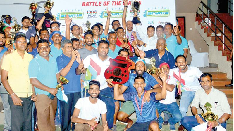 The winning Insurance Corporation teams with their Trophies presented by Chief guest former  Sri Lanka cricketer Graeme Labrooy along with Krishantha Cooray the chairman of ANCL Lake House who were the sponsors